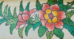 Peinture de fleur sur le mur de granit Photographie stock libre de droits