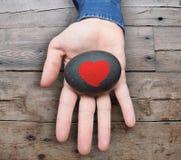 Peinture de forme de coeur sur la pierre Photographie stock libre de droits