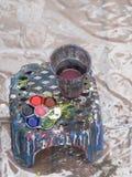 Peinture de l'eau de couleur sur la terre Photo libre de droits