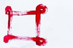 Peinture de main de couleur rouge sur le papier Photographie stock libre de droits