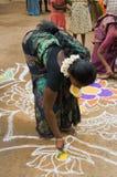 Peinture de sable de femme Photo stock