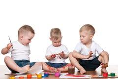Peinture de trois enfants Photos stock