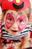 Peinture de visage de papillon Photo stock