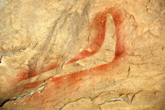 Peinture indigène de roche, boomerang Image libre de droits