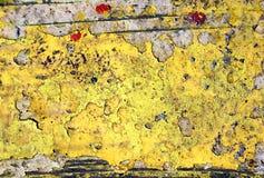 Peinture jaune sur le bois photo stock