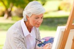 Peinture mûre de femme photo libre de droits