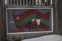 Peinture murale communiste patriotique d'armée dans la cintreuse, le Transnistrie images stock