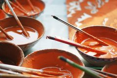 Peinture orange chinoise Photographie stock