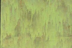 Peinture peinte de vert en métal avec des taches et des marques de brosse image libre de droits