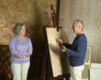 Peinture pluse âgé de couples avec le chevalet Images stock
