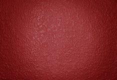 Peinture rouge foncé texturisée Photos stock