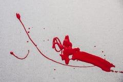 Peinture rouge renversée Photo stock