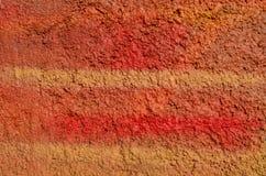 Peinture rouge rugueuse de graffiti Photographie stock