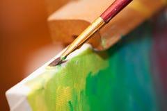 Peinture sur un chevalet Photo libre de droits