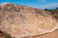 Peintures antiques, pétroglyphes sur les roches près de l'Issyk-Kul, Image stock