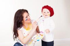 Peintures de mère et de petit garçon une fois peint Image stock