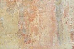 Peintures rouges et jaunes sur le vieux mur Photos libres de droits