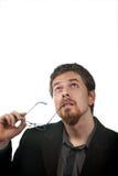 Peinzende bedrijfsmens die voor oplossingen denkt Stock Fotografie