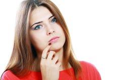 Peinzende jonge vrouw Stock Afbeelding