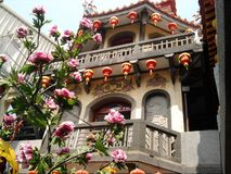 Peitian Temple - Bell tower And flowers royalty free stock photo