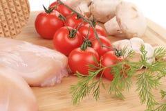 Peito de frango cru com vegetais Imagem de Stock Royalty Free