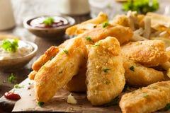 Peixe com batatas fritas friável fotografia de stock