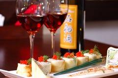Peixes com vinho vermelho Imagens de Stock Royalty Free