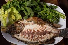 Peixes cozidos com molho de marisco Foto de Stock