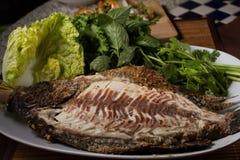 Peixes cozidos com molho de marisco Imagem de Stock Royalty Free