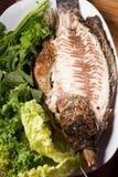 Peixes cozidos com molho de marisco Fotografia de Stock