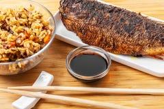 Peixes cozinhados com arroz imagens de stock