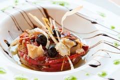 Peixes de bacalhau e prato doce da pimenta vermelha. Fotos de Stock