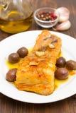 Peixes de bacalhau fritados com alho e azeite Imagem de Stock