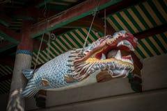 Peixes de madeira do templo do nanputuo fotografia de stock