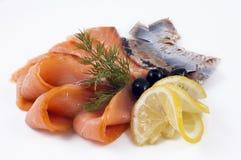 Peixes de mar com limão Imagens de Stock Royalty Free