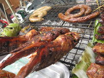 Peixes e carne de porco Roasted Fotografia de Stock