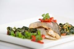 Peixes e espinafres Foto de Stock