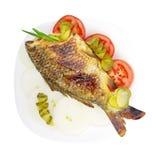 Peixes em uma placa. Imagens de Stock