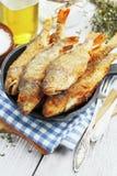 Peixes fritados em uma frigideira Imagens de Stock Royalty Free