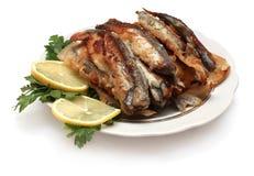 Peixes grelhados com limão e salsa Imagens de Stock Royalty Free