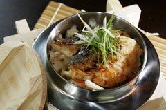 Peixes no arroz Fotografia de Stock