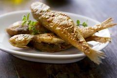 Peixes pequenos fritados Fotografia de Stock Royalty Free