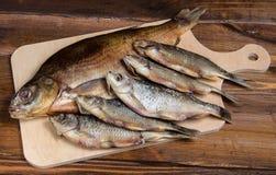 Peixes secados em uma tabela de madeira Fotos de Stock Royalty Free