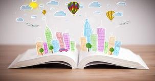 Pejzażu miejskiego rysunek na otwartej książce zdjęcia stock