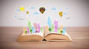 Pejzażu miejskiego rysunek na otwartej książce obrazy stock