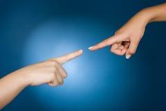 peka för händer Arkivfoton
