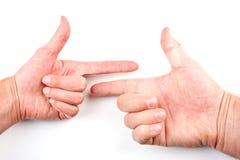 peka för händer Arkivbilder