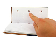 peka för hand för kalenderdatum Arkivfoton