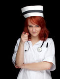 peka för kvinnligsjuksköterska Arkivfoton