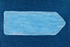 Pekare som göras av grov bomullstvilltyg med guling som syr på mörk grov bomullstvill, med utrymme för din text Arkivfoto